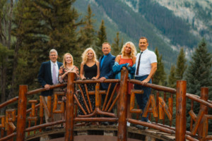 Father Teen Adventure group of fathers and daughters pose on a bridge at Spring Canyon.