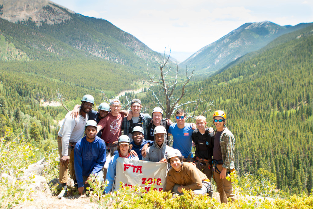 Father Teen Adventure men pose in front of Cottonwood pass.
