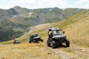 ATVs summit a ridge during Father Teen Adventure.