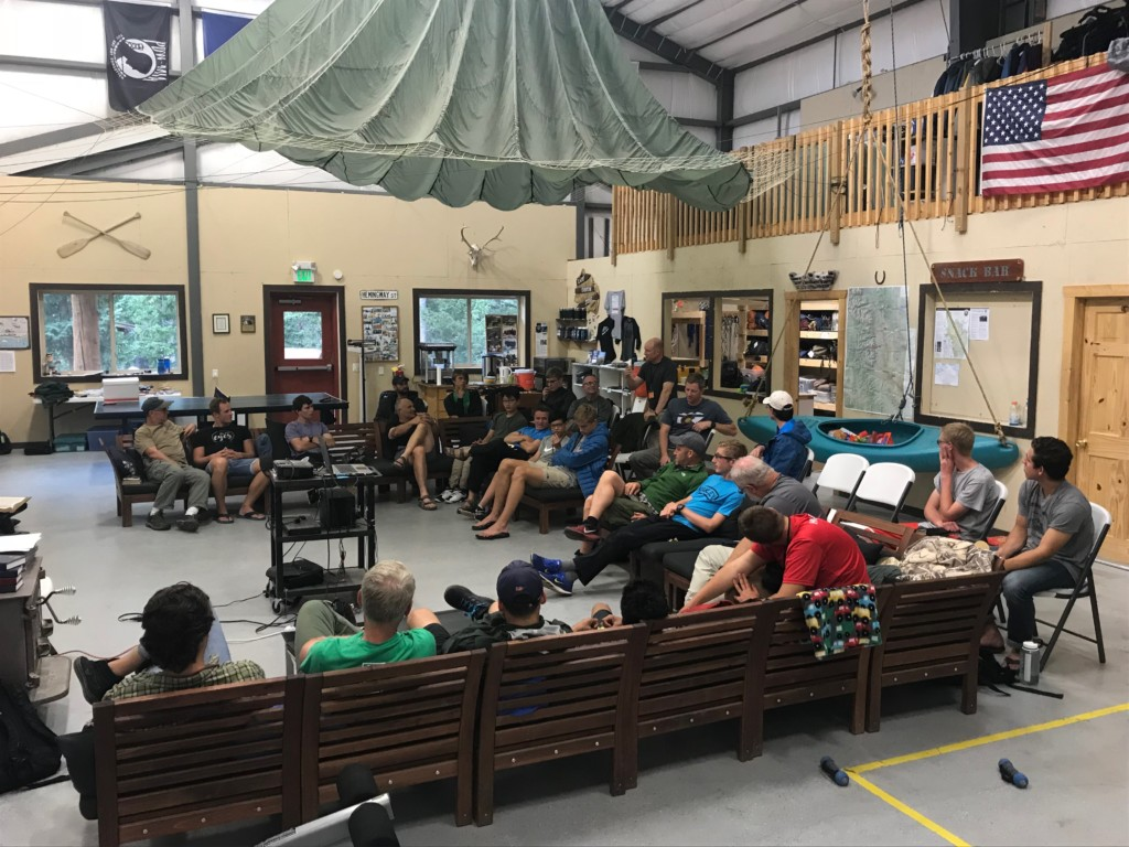 Father Teen Adventure group discussion in the outdoor complex.